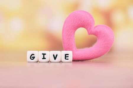 Give love with pink heart for donate and philanthropy health care love organ donation family insurance and CSR concept world heart day world health day  Concepts of sharing giving or  valentines day