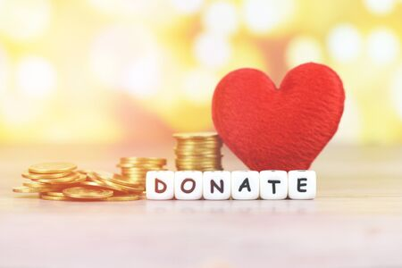Money saving with red heart for donate and philanthropy  health care love organ donation family insurance and CSR concept world heart day world health day , Coins on table for money donation to poor