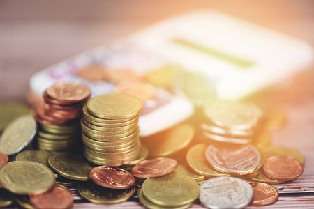 Save money Coins on table  Pile of Golden coin, silver coin and copper coin with calculator money financial for businessman working accounting concept