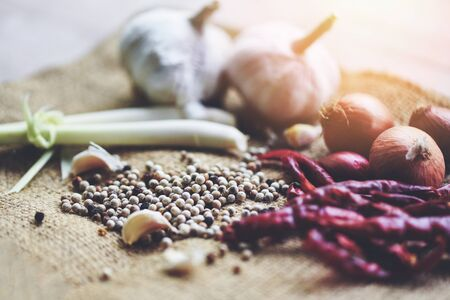 herbs and spices ingredients spicy for Tom Yum thai with lemon grass garlic dried chilli Shallot and pepper seed , Thai Food Asian on sack Imagens