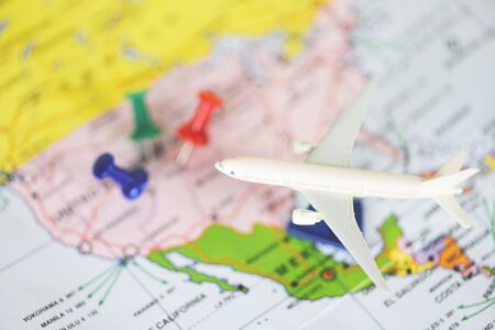 Travel time or plan for travelling concept  travel planning with airplane destination points on a map pin , selective focus Imagens