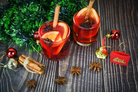 red mulled wine glasses decorated table  Christmas mulled wine delicious holiday like parties with orange cinnamon star anise spices for traditional christmas drinks winter holidays