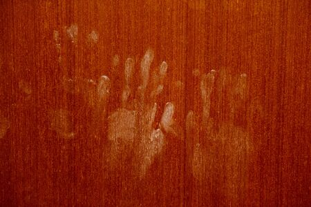 Hand marks on wooden wall / hand prints Horror scary dirty fingerprint The concept of loneliness and abandonment and Horror scary Ghost in home door on Halloween