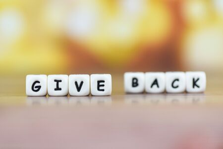 Concept of give back word health care, love, organ donation, family insurance and CSR concept  Give Back text on table