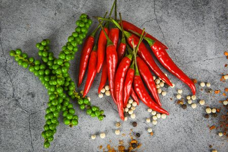 peppercorns and fresh red chilli on dark background  fresh green peppercorn and pepper seed for ingredients cuisine thai food herbs and spices Banco de Imagens