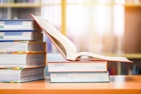 Education concept back to school and business study  open book in library with book stacked on the table  Banco de Imagens