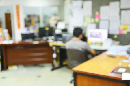 Blurred Image of man is working office desk Banco de Imagens