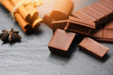 Chocolate bar and spice on dark background sweet dessert for snack , selective focus