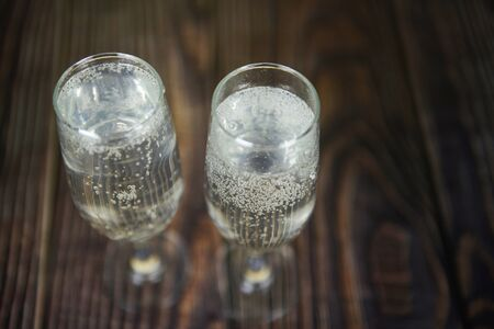 prosecco glass holiday drinks like themed party and holiday celebration concept with Champagne glasses for winter holidays decorated christmas on wooden table background