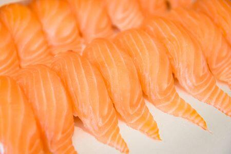 Salmon sashimi japanese food sushi menu with salmon fillet in the restaurant  Sashimi set Japanese cuisine fresh ingredients on white plate , top view selective focus