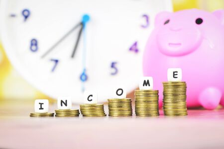 income growth money coins on table  Pile of golden coin stack step up growing growth saving concept with piggy bank and time clock money financial business