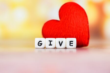 Give love with red heart for donate and philanthropy health care love organ donation family insurance and CSR concept world heart day world health day  Concepts of sharing giving or valentines day Banco de Imagens