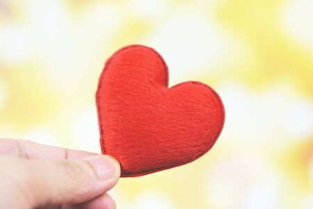 heart on hand for philanthropy concept  man holding red heart in hands for valentines day or donate help give love warmth take care