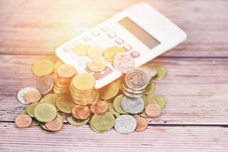 calculator money finance object business accounting concept  counting coins money calculator on old wooden background