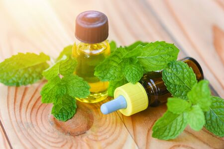 Aromatherapy herbal bottles aroma with mint leaves herbal formulations including and herbs  peppermint oil , Essential Oil natural and green background