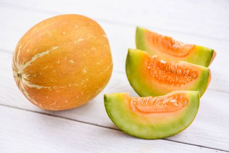 Muskmelon sliced cantaloupe thai tropical fruit asian on wood background  melon yellow Banco de Imagens