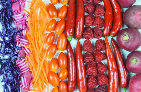Vegetables and fruits background healthy food for life  Assorted fresh fruit orange red and purple vegetables mixed selection chilli carrot raspberry radish tomato for health