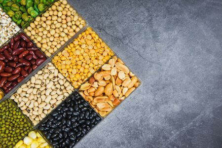 Box of different whole grains beans and legumes seeds lentils and nuts colorful snack background top view  Collage various beans mix peas agriculture of natural healthy food for cooking ingredients
