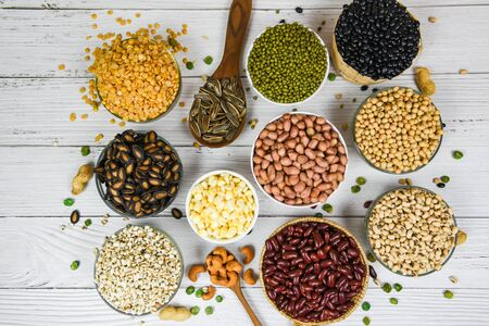 Different whole grains beans on bowl and legumes seeds lentils and nuts colorful snack background top view  Collage various beans mix peas agriculture of natural healthy food for cooking ingredients