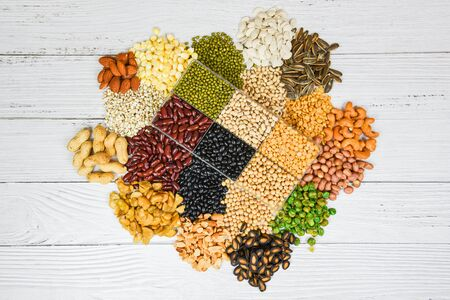 Set of different whole grains beans and legumes seeds lentils and nuts colorful snack background top view  Collage various beans mix peas agriculture of natural healthy food for cooking ingredients Stock Photo