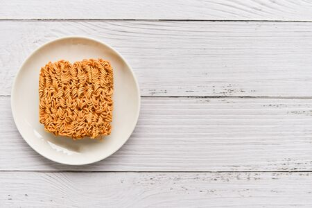 Instant noodles on bowl  Noodle thai junk food or fast food diet unhealthy concept , top view copy space