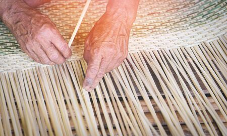 Weaving bamboo basket wooden / Old senior man hand working crafts hand made basket for nature product in Asian