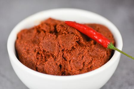 curry paste and red chilli peppers background / ingredients table asian food spicy in thailand