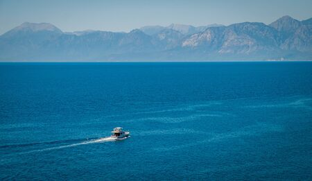 Ferry boat on blue sea and mountain background  Beautiful Turkey landscape travel landmark