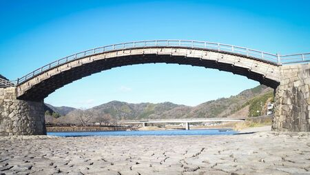 Iwakuni Yamaguchi Japan Kintaikyo Bridge over the Nishiki River with blue sky  The 5-arched wooden bridge is a cultural property of Japan