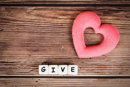 Give love with pink heart for donate and philanthropy health care love organ donation family insurance and CSR concept world heart day world health day  Concepts of sharing giving or valentines day Stok Fotoğraf