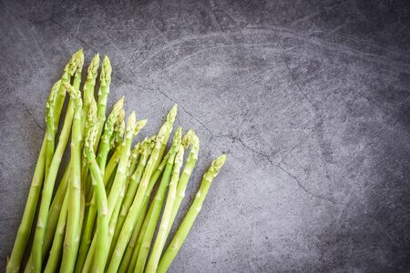 Fresh Asparagus on black background  Bunch green asparagus organic for cooking food
