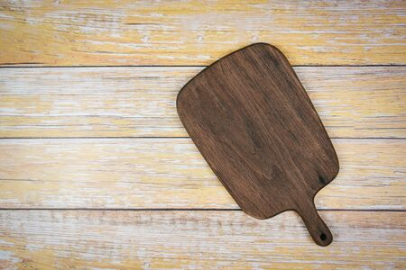 Chopping board natural kitchen tools wood products  Kitchen utensils with wooden cutting board background , top view