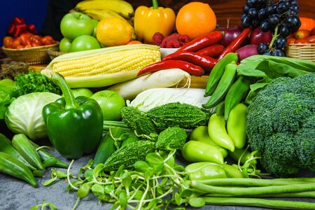 Assorted fresh ripe fruit red yellow and green vegetables market harvesting agricultural products / Mixed vegetables and fruits background healthy food clean eating for health