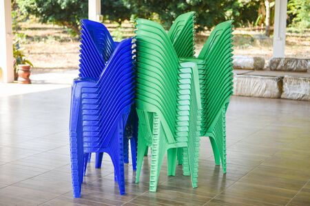 Green and blue chair storage on stack / Plastic chair