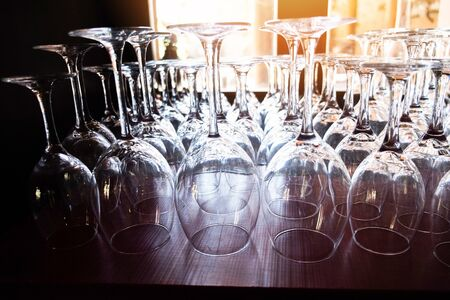 Wine glass on the table background / champagne glass for celebration party , selective focus