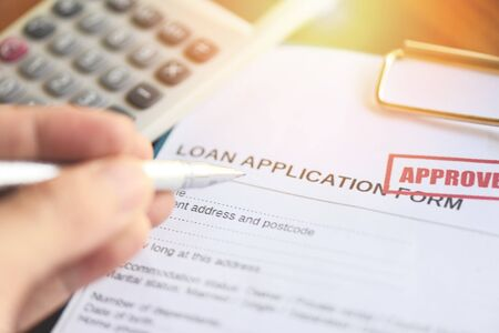 Financial loan calculator or lending for car and home loan application agreement / Loan approval concept Foto de archivo