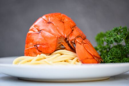 Spaghetti seafood lobster food on a white plate  spaghetti shrimp dinner with herb spices lemon served table in the restaurant gourmet food healthy boiled lobster tail cooked