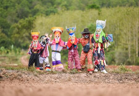 Phi ta khon festival ghost mask and colorful costume fun traditional thailand mask the show art and culture loei province Dan Sai thailand festival / phi ta khon or halloween of Thailand
