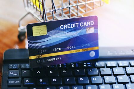 Online payment credit card on keyboard and shopping cart background  shopping online technology and credit card payment concept