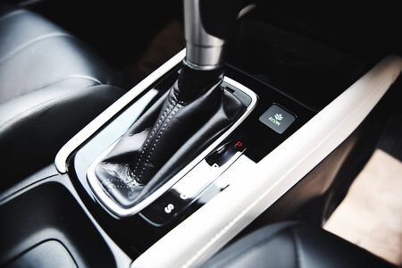 Automatic car transmission shift lever interior car detail / automatic gear and button econ mode Reducing fuel consumption Stock Photo