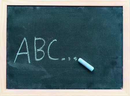 Blackboard dark or chalkboard with horizontal and banner / blackboard texture chalk draw and write A B C for education in school chalkboard background , selective focus