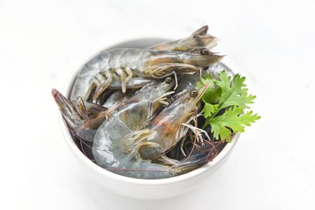 fresh shrimp on bowl isolated on white background / raw shrimps prawns for cooking seafood Stock fotó