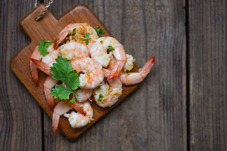 Shrimp delicious seasoning spices on wooden cutting board background / cooked shrimps or prawns , Seafood shelfish Фото со стока