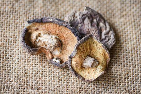 Dried shiitake mushrooms for food ingredients and herbal medicine / Dry mushrooms on the sack Фото со стока