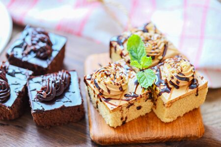 Coffee cake topping chocolate delicious sweet dessert served on the table / cake chocolate slice on wooden with mint leaf for breakfast