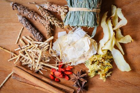 Herbal medicine dried herb from nature Non-toxic organic product on wooden background / Dry spices and herbs dood ingredients in Thailand Asian for healthy lifestyle
