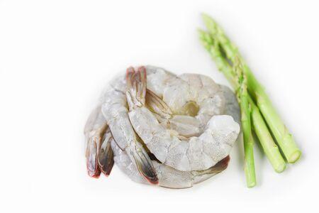 Asparagus Shrimp Seafood / Fresh raw shrimps prawns with green asparagus on white background