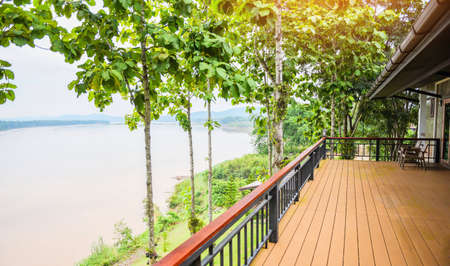 balcony and nature green tree forest / balcony view river , terrace house