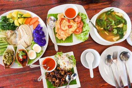 thai food top view , asian food served on wooden table setting with plate menu in thailand