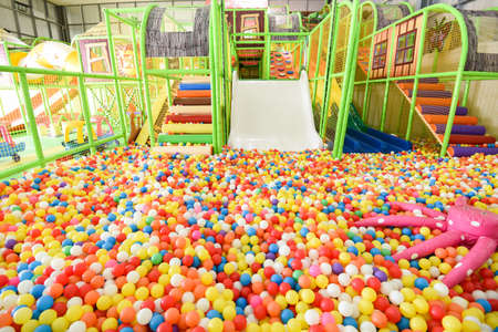 Children playground indoor at amusement park / Inside the beautiful kids playground with plastic dry pool with colorful balls for playing